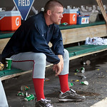 Washington Nationals starting pitcher Stephen Strasburg sits in the dugout after being pulled from the game after loading the bases in the sixth inning of a baseball game against the Clevela ...