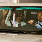 Free agent basketball player LeBron James, left, is driven out of the IMG building in downtown Cleveland, after meeting with representatives of the New Jersey Nets and the New York Knicks ba ...
