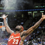 FILE - In this Nov. 18, 2008, file photo, Cleveland Cavaliers' LeBron James throws chalk dust into the air before playing in an NBA basketball game against the New Jersey Nets in East Ruther ...