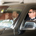 New York Knicks president James Dolan, left, is driven out of the IMG building in downtown Cleveland, after meeting with free agent basketball player LeBron James on Thursday, July 1, 2010.  ...