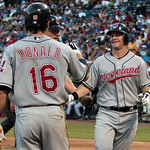 Cleveland Indians Matt LaPorta is congratulated by teammates after hitting a two-run homer in the third inning of a baseball game Monday, July 5, 2010, in Arlington, Texas. (AP Photo/Cody Du ...