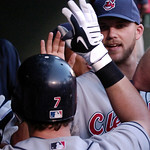 Cleveland Indians Matt LaPorta high fives teammates after hitting a two-run homer in the third inning of a baseball game Monday, July 5, 2010, in Arlington, Texas. (AP Photo/Cody Duty)