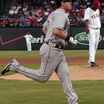 Cleveland Indians Matt LaPorta, left, rounds the bases after hitting a two-run homer off of Texas Rangers pitcher Omar Beltre, right, in the third inning of a baseball game Monday, July 5, 2 ...