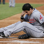Cleveland Indians infielder Matt LaPorta (7) lies  on the ground after being hit in the head by an elbow form Texas Rangers' Elvis Andrus (1) during a play at first base in the third inning  ...