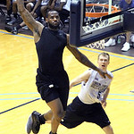 LeBron James goes to the basket on a fast break during the evening workout games with high school basketball players at his skills academy on Tuesday, July 6, 2010, in Akron, Ohio. (AP Photo ...