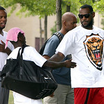 LeBron James, right, and Damon Jones, left,  arrive at the James A. Rhodes Arena for the LeBron James Skills Academy on Tuesday, July 6, 2010 in Akron, Ohio.  James met with six teams last w ...