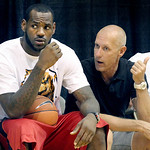 LeBron James, sits with publicist Keith Estabrook, during afternoon workout at the LeBron James Skills Academy on Tuesday, July 6, 2010 in Akron, Ohio.  James met with six teams last week, i ...