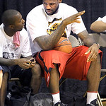 LeBron James, talks with business partner Rich Paul, during afternoon workout at the LeBron James Skills Academy on Tuesday, July 6, 2010 in Akron, Ohio.  James met with six teams last week, ...