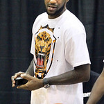 LeBron James stands on the sidelines during afternoon workout at the LeBron James Skills Academy on Tuesday, July 6, 2010 in Akron, Ohio.  James met with six teams last week, including the C ...