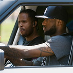 NBA free agent LeBron James, foreground,  drives away with Cleveland Cavaliers basketball player Damon Jones after a workout at the LeBron James Skills Academy for high school and college ba ...