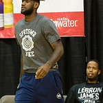 NBA free agent LeBron James walks on the court to talk with high school players at the LeBron James Skills Academy for high school and college basketball players  at Rhodes Arena on the Univ ...