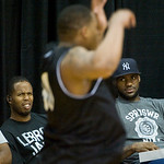NBA free agent LeBron James, right, and Cleveland Cavaliers player Damon Jones watch high school players scrimmage at the LeBron James Skills Academy for high school and college basketball p ...