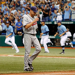 Cleveland Indians pitcher Kerry Wood walks off the field after giving up a game-winning single to the Tampa Bay Rays' Jason Bartlett in the bottom of the tenth inning of a baseball game Sund ...