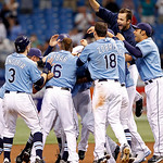 Members of the Tampa Bay Rays swarm Jason Bartlett after his game-winning single in the bottom of the tenth inning for a 6-5 win over the Cleveland Indians in of a baseball game Sunday, July ...
