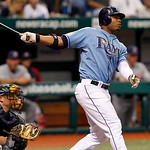 Tampa Bay Rays' Carl Crawford, right, hits a two-run home run in the fourth inning in front of Cleveland Indians catcher Chris Gimenez during a baseball game Sunday, July 11, 2010, in St. Pe ...