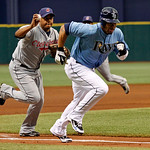 Tampa Bay Rays' Carl Crawford, right, avoids the tag from Cleveland Indians third baseman Andy Marte on his way to scoring during a rundown in the first inning of a baseball game Sunday, Jul ...