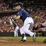 Minnesota Twins' Joe Mauer lays down a sacrifice bunt against the Cleveland Indians to advance runners to second and third in the seventh inning of a baseball game Tuesday, July 20, 2010 in  ...