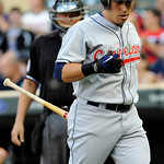 Cleveland Indians' Asdrubal Cabrera, who returned to the lineup after 60 days on the disabled list, returns to the dugout after striking out to Minnesota Twins' Kevin Slowey in the first inn ...