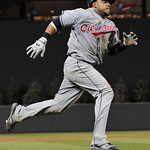 Cleveland Indians' Carlos Santa races home to score the go-ahead run on a double by Travis Hafner off Minnesota Twins pitcher Jose Mijares in the eighth inning of a baseball game Tuesday, Ju ...