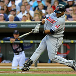 Cleveland Indians' Carlos Santana hits a single off Minnesota Twins' Kevin Slowey during the first inning of a baseball game Tuesday, July 20, 2010 in Minneapolis. (AP Photo/Jim Mone)