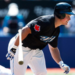 Toronto Blue Jays' Travis Snider runs to first base after hitting a single to right field while playing against the Cleveland Indians during ninth-inning AL baseball game action in Toronto o ...