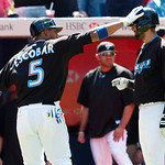 Toronto Blue Jays' Jose Bautista, right, is patted on the helmet by teammate Yunel Escobar after Escobar hit a solo home run against the Cleveland Indians during seventh-inning AL baseball g ...