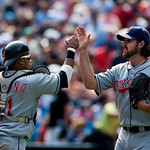 Cleveland Indians closing pitcher Chris Perez, right, celebrates with Indians catcher Carlos Santana, left, after defeating the Toronto Blue Jays 5-4 during AL baseball game action in Toront ...