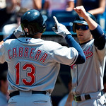 Cleveland Indians' Asdrubal Cabrera, left, celebrates his two-run home run with teammate Trevor Crowe, right, during first-inning AL baseball game action against the Toronto Blue Jays in Tor ...