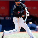 Toronto Blue Jays' Jose Bautista hits a ground ball and is thrown out at first base against the Cleveland Indians during fifth-inning AL baseball game action in Toronto on Sunday, Aug. 1, 20 ...