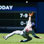 Cleveland Indians second baseman Jason Donald misses a diving catch on a ball hit by Toronto Blue Jays' Vernon Wells during fourth-inning AL baseball game action in Toronto on Sunday, Aug. 1 ...