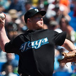 Toronto Blue Jays starting pitcher Jesse Litsch throws against the Cleveland Indians during first-inning AL baseball game action in Toronto on Sunday, Aug. 1, 2010. (AP Photo/The Canadian Pr ...
