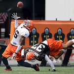 Cleveland Browns wide receiver Josh Cribbs, left, makes a one-handed catch of a pass from quarterback Jake Delhomme, as cornerback Chris Roberson (37) falls to the ground during the Browns N ...