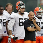 Cleveland Browns offensive coordinator Brian Daboll, second from right, works the sidelines along with players, from left, tight end Benjamin Watson (82),  offensive lineman Joel Reinders, d ...
