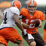 Cleveland Browns quarterback Colt McCoy hands the ball off to running back Chris Jennings during the Browns NFL football training camp in Berea, Ohio on Wednesday, Aug. 4, 2010.  (AP Photo/A ...