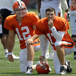This Aug. 1, 2010, photo shows Cleveland Browns quarterbacks Colt  McCoy, left, and Jake Delhomme share the sidelines during the Browns NFL football training camp in Berea, Ohio.  (AP Photo/ ...