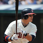 Cleveland Indians' Shin-Soo Choo knocks in a run with a single in the first inning of a baseball game against the Minnesota Twins in Cleveland, Sunday, Aug. 8, 2010. (AP Photo/David Richard)