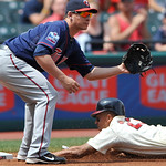 Cleveland Indians Michael Brantley, right, slides into third base with a triple as MInnesota Twins third baseman Danny Valencia waits on the relay throw in a baseball game in Cleveland, Sund ...