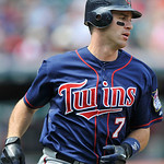 Minnesota Twins' Joe Mauer rounds first base after hitting a single against the Cleveland Indians in a baseball game in Cleveland, Sunday, Aug. 8, 2010. (AP Photo/David Richard)