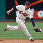 Cleveland Indians shortstop Asdrubal Cabrera misses the ball on an infield base hit by Minnesota Twins' J.J. Hardy in the fifth inning of a baseball game in Cleveland, Sunday, Aug. 8, 2010.  ...