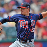 Minnesota Twins pitcher Brian Duensing delivers against the Cleveland Indians in the first inning of a baseball game in Cleveland, Sunday, Aug. 8, 2010. (AP Photo/David Richard)