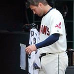 Cleveland Indians pitcher David Huff walks to the clubhouse after being lifted from the game in the fifth inning of a baseball game against the Minnesota Twins in Cleveland, Sunday, Aug. 8,  ...