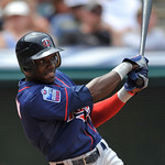 Minnesota Twins' Orlando Hudson doubles in two runs in the fifth inning in a baseball game against the Cleveland Indians in Cleveland, Sunday, Aug. 8, 2010. (AP Photo/David Richard)