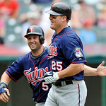 Minnesota Twins' Jim Thome, right, is congratulated by teammate Michael Cuddyer after hitting a two-run home run against the Cleveland Indians in a baseball game in Cleveland, Sunday, Aug. 8 ...