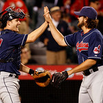 Cleveland Indians catcher Lou Marson and pitcher Chris Perez celebrate a 3-2- win over the Los Angeles Angels in a baseball game on Sept. 6, 2010 in Anaheim, Calif.  (AP Photo/Christine Cott ...