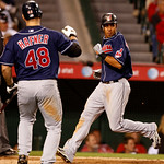 Cleveland Indians Michael Branley crosses home plate with the wimning run on a single by Shin-Soo Choo in the ninth inning of a baseball game against the Los Angeles Angels in Anaheim, Calif ...