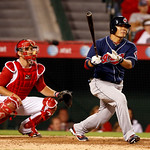 Cleveland Indians Shin-Soo Choo hits an RBI single in the ninth inning to score the winning run in a baseball game against the Los Angeles Angels in Anaheim, Calif., on Monday, Sept. 6, 2010 ...