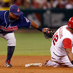 Los Angeles Angels Alberto Callaspo is caught stealing by Cleveland Indians second baseman Luis Valbuena in the fifth inning of a baseball game in Anaheim, Calif., on Monday, Sept. 6, 2010.  ...