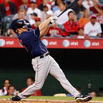 Cleveland Indians Shelley Duncan hits a sacrifice fly to center field in the fourth inning to score Travis Hafner in a baseball game in Anaheim, Calif., on Monday, Sept. 6, 2010. (AP Photo/C ...