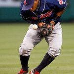 Cleveland Indians second baseman Luis Valbuena bobbles the ball but recovers in time to make an out at first base on Los Angeles Angels Howie Kendrick in the third inning of a baseball game  ...