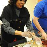 Selina Gaddis, of LCCC Student Senate, serves Pumkin Pie Milkshake drink at the 11th annual Zero-Proof Mix-Off at LCCC on Dec. 6.  Steve Manheim